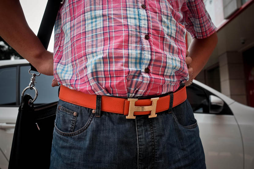 A mine owner displays his Hermès designer belt in Shenmu, Shaanxi province, July 22, 2013.  Zhou Pinglang/Sixth Tone
