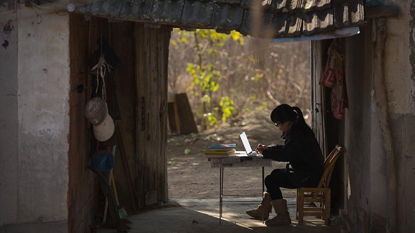 A still frame from 'Still Tomorrow' shows Yu Xiuhua typing on her computer. Courtesy of Fan Jian